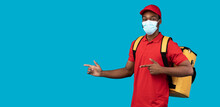 African American Delivery Guy In Mask Pointing At Copy Space