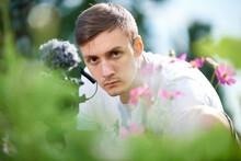 Serious Male Photographer Natu...