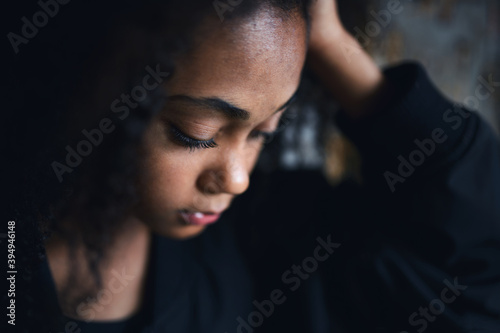 Fototapeta Close-up portrait of sad mixed-race teenager girl standing, bullying concept. obraz