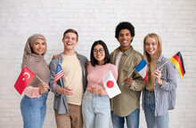 Multiethnic Young Students With Flags Of Different Countries Ready To Study