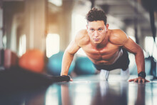 Young Male Push Up Exercise To Build Up Chest Muscle Strength At Fitness Sport Club.