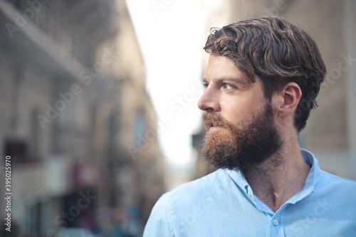 Obraz portrait profile of a handsome man in the street - fototapety do salonu