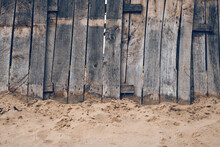 Worn Reclaimed Wood Beach Fence As Background And Copy Space
