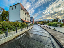 View Of Footpath By Buildings Against Sky