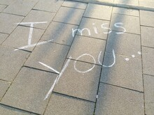 High Angle View Of I Miss You Text On Footpath