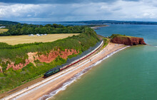 Royal Scot 46100 Rounds Langstone Rock With Saphos Trains Torbay Express At Dawlish Warren. Taken With A Mavic 2 Pro Hasselblad Drone.