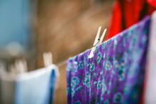 Close-up Of Multi Colored Clothes Drying Outdoors
