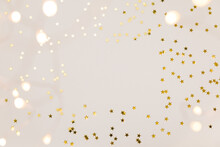 Festive Gold Background. Shining Stars Confetti And Fairy Lights On Beige And Set Sail Champagne Background. Christmas. Wedding. Birthday. Flat Lay, Top View, Copy Space
