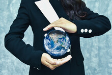 Digital Composite Image Of Woman Protecting Earth
