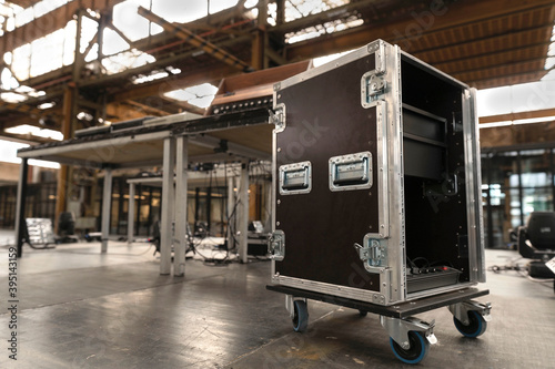 Leinwand Poster Installation of professional sound, light, video and stage equipment cases
