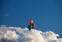 Low Angle View Of Hot Air Balloons Flying In Blue Sky