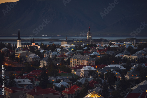 Fotografering Beautiful night dusk view of Reykjavik, Iceland, aerial view with Hallgrimskirkj