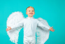 Angelic Child Boy Cupid With Angel Wings.