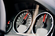 Close-up Of Car Speedometer With Fuel Gauge