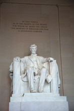 Statue Of Abraham Lincoln With Text On Wall