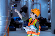 Industry Worker Under Checking The Industry Cooling Tower Air Conditioner Is Water Cooling Tower Air Chiller HVAC Of Large Industrial Building To Control Air System