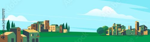 Photo Paesaggio della pianura e città con degli alberi e cielo azzurro