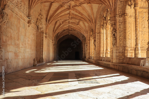 Archway of an old monastery. Cloisters of Jeronimos Monastery Fotobehang