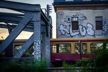 Train Passing A Graffiti Wall In An Urban Surrounding
