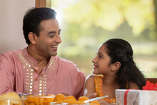 Father Looks At Daughter With Affection During Diwali Celebrations