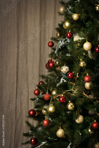 Fototapeta Christmas tree with white and red balls on linen fabric background obraz