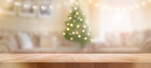 A Wood Table, Tabletop Product Display With A Festive Christmas Background Of Christmas Tree And Fairy Lights.