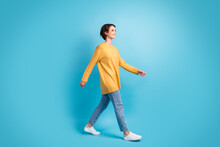 Full Length Body Size Side Profile Photo Of Girl Walking Fast Smiling Isolated On Bright Blue Color Background