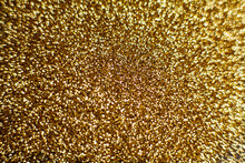 Gold Dust Background Blurred, Small Gold Dust Reflects Light