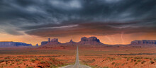 Landscape Approaching Monument Valley In Utah At Mile Marker 13 During A Lightening Storm