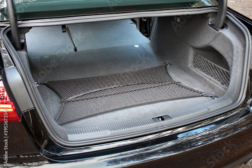GRODNO, BELARUS - DECEMBER 2019: Audi A6 4G, C7 2.0 TDI 190 Hp 2016 facelift Clean, open empty transformated car trunk with safty mesh. Transformation of rear seats for carrying luggage in cabin.