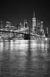 Black and white night view of Manhattan waterfront, New York City, USA.