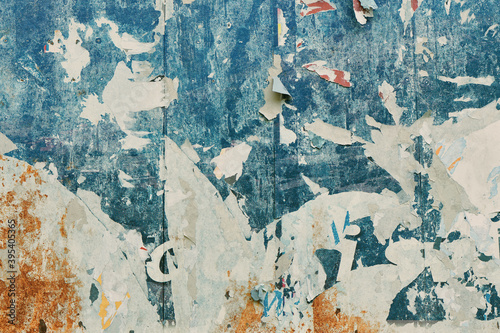 Obraz Torn poster paper surface as abstract grunge background, worn damaged printed billboard advertisement - fototapety do salonu