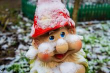 Figurine Of A Garden Gnome In A Garden Under The Snow In Winter. 21 November 2020, Minsk, Belarus