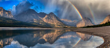Beautiful Panoramic View Of American Rocky Mountain Landscape. Dramatic Sunrise Sky With Rainbow. Art Render. Taken In Glacier National Park, Montana, United States.