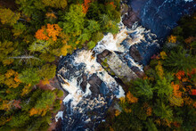 Beautiful Look Down Travel Photograph Of The Upper Potato River Falls Waterfall Cascades And Whitewater Rapids Cutting Through The Deciduous And Evergreen Forest Wilderness In Wisconsin.