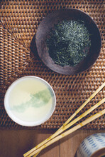 Loose Green Tea On A Plate And Brewed In A Tea Bowl