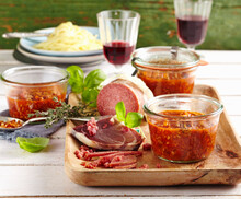 Bolognese Sauce In Preserving Jars Served With Parma Ham And Salami