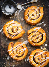 Danish Pastries Cinnamon Swirls On A Baking Tray Decorated With Icing