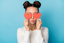 Photo Of Romantic Girl Hide Eyes Red Paper Hearts Blow Air Kiss Wear White Sweater Isolated Blue Color Background