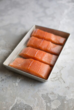 Raw Salmon Fillets In A Tin Bowl