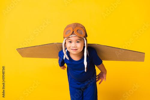 Slika na platnu Happy Asian handsome funny child or kid little boy smile wear pilot hat playing