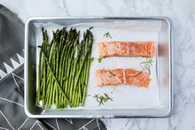 Salmon And Asparagus In The Pan, Ready For Oven, Seasoned With Olive Oil And Rosemary