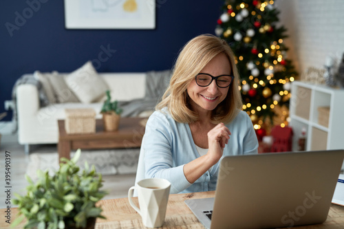 Cuadros en Lienzo Mature woman during video conference over the holiday season
