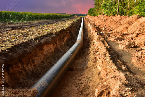 Canvas Print Construction Gas Pipeline Project on amazing sunset background