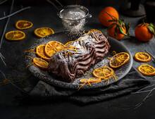 Chocolate Log With Hints Of Orange Orange Peel With Icing Sugar Dusting
