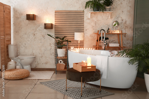 Obraz Interior of modern bathroom with burning candles in evening - fototapety do salonu