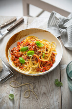 Spaghetti With Bolognese Sauce, Parmesan Cheese And Basil
