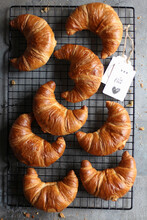 Homemade Croissants On A Cooling Rack With Jam