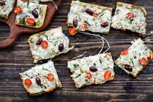 Artisan Pizza With Mozzarella Cheese, Fresh Tomatoes, Goats Cheese, Spinach, Kalamata Olives And Pesto
