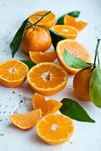 Oranges With Leaves, Whole, Halved And Slices